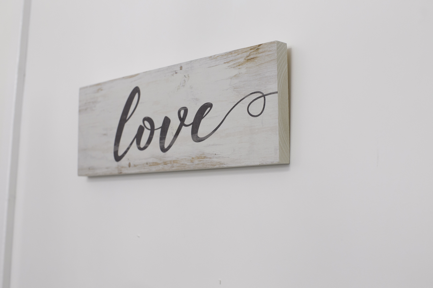 Wooden sign that says Love